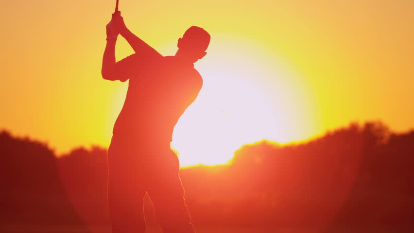 Close up silhouette weekend male golfer enjoying time golf course in summer driving off down fairway sunset shot on RED EPIC, 4K, UHD, Ultra HD resolution | Shutterstock Video #5337542