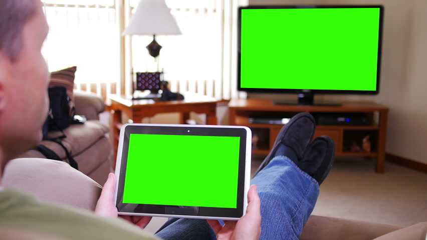 A man watches television while holding a tablet device.  Screens customizable with included optional luma matte and tracking points for advanced tracking.