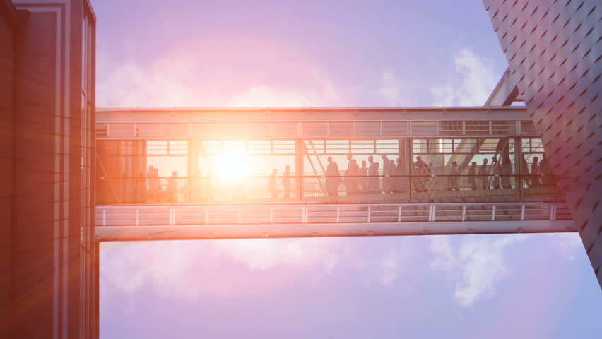 people walking. sunset sun flare dusk. group team together. crowd of people. modern building. intro connection.