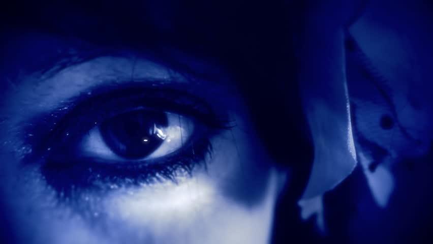 A woman's eye moving. Retro vintage blue coloring applied. Macro shot. #5356700