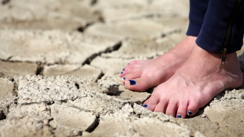 Barefoot female with pedicure walking on dry land #5360120