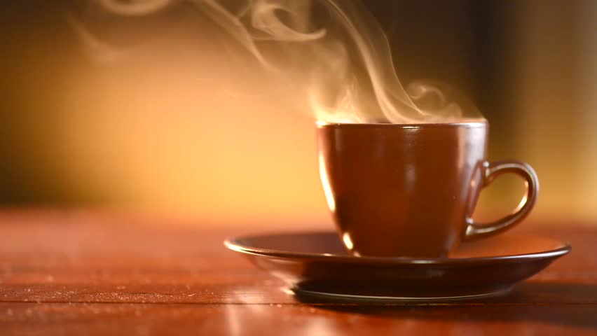 Coffee or Tea. Brown Cup of hot beverage with Steam. Espresso Coffee closeup. HD video Footage