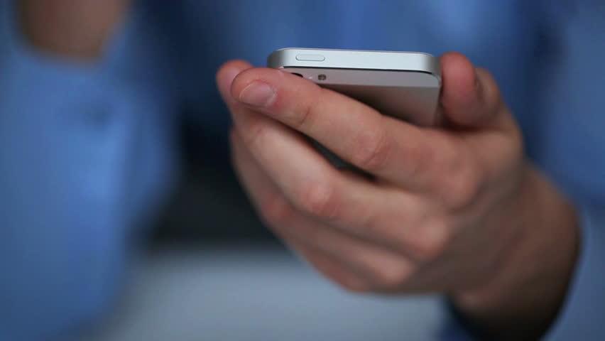Man using smartphone for text messaging | Shutterstock HD Video #5371010