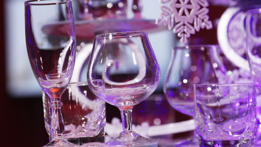 Elegantly decorated Christmas table. In the background, TV works   Shutterstock HD Video #5373260