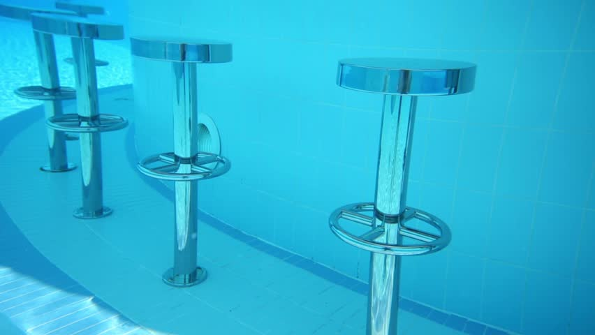 pool bar furniture. round metal bar chairs underwater in pure blue pool and bottom hd stock footage clip furniture