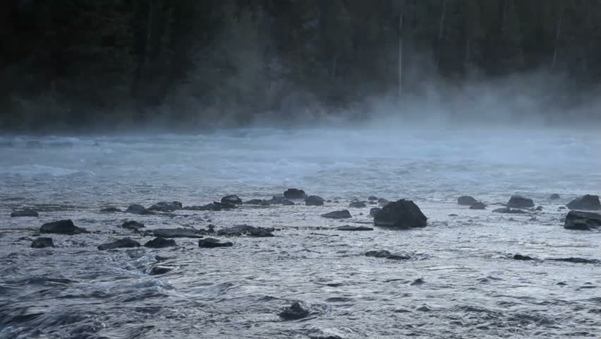 Yellowstone River with mist drifting over the water. Romantic and peaceful with a hint of mystery.