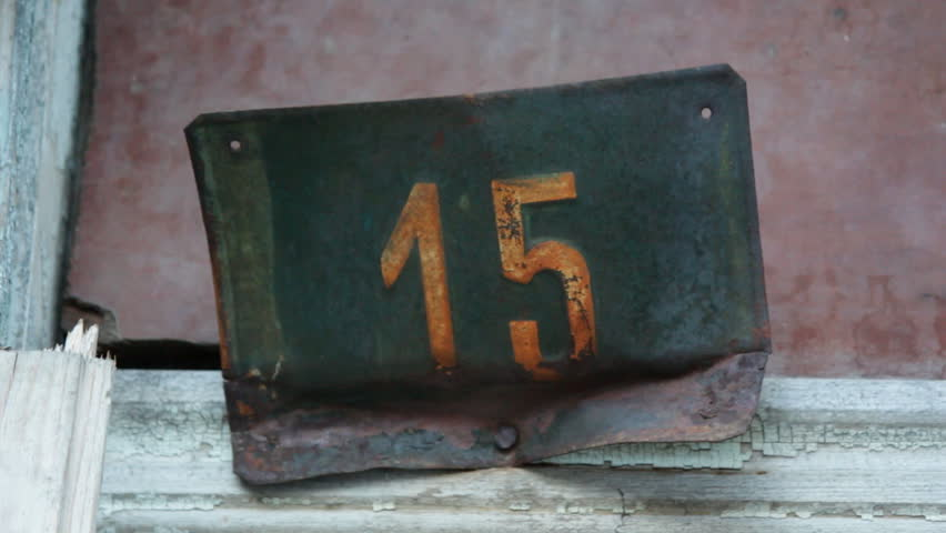 Old rusty house number fifteen