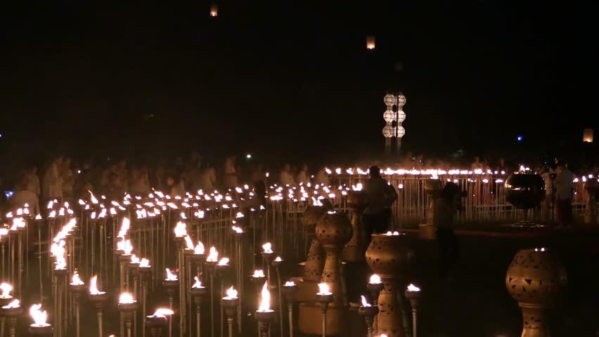 CHIANG MAI - NOVEMBER 2013: Lanna Kathina Monks Meditation, Yee Peng Festival of lights and lanterns, Mae Jo, Chiang Mai, Thailand, 2013 At the end of meditation monks and volunteers fire up pillars.