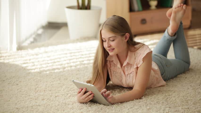 Young Woman Lying On The Floor Using A Tablet Computer -7932