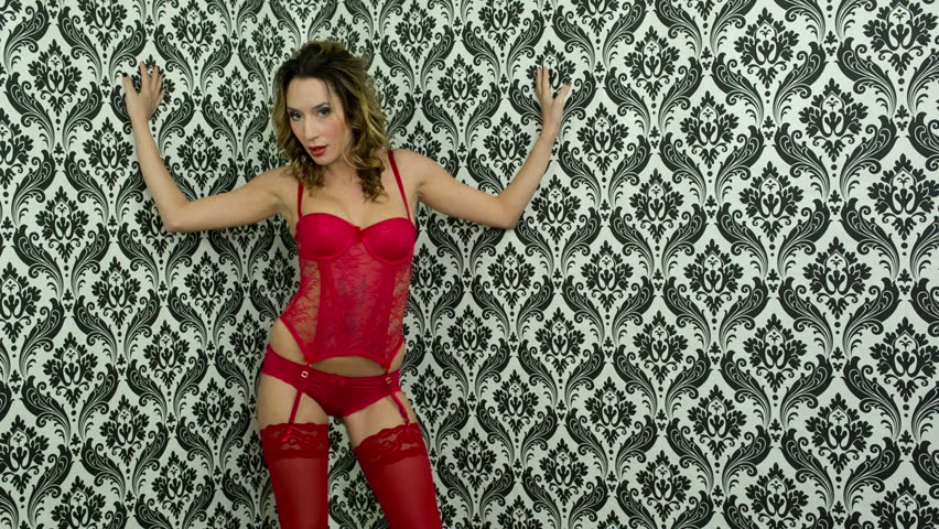00aec90b8 beautiful sexy woman poses and dances in red lingerie against a cool  vintage wallpaper. good clip for party