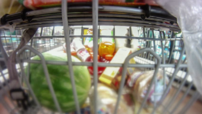 Shopping cart point of view down the aisles as the cart gets filled through checkout and to parking lot  time lapse