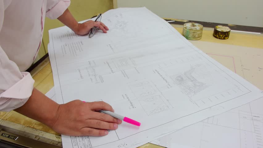 An asian architect is checking his architecture plan blueprint of an asian architect is checking his architecture plan blueprint of a building with pink marker pen in his office stock footage video 5541890 shutterstock malvernweather Image collections