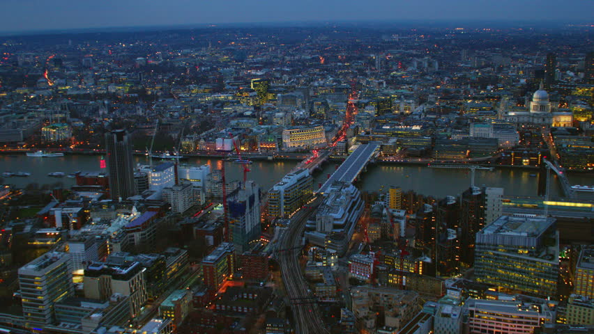 4K Aerial shot of Central London at night with view of London Eye, River Thames, OXO Tower, Blackfriars Bridge, St Paul's Cathedral