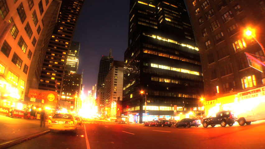 Night time-lapse w/fish-eye of traffic & lights on Broadway, New York City, USA