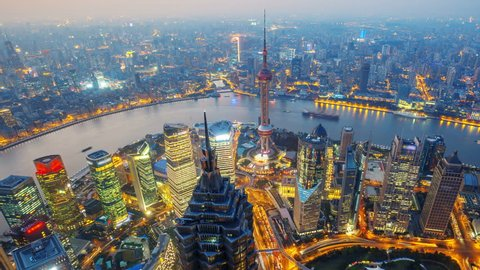Shanghai from day to night (Panning Shot, 4k Time-Lapse).  Aerial view of high-rise buildings with Huangpu River in Shanghai, China. - >>> Please Search Newest Featured Similar Clip: 1020262945.