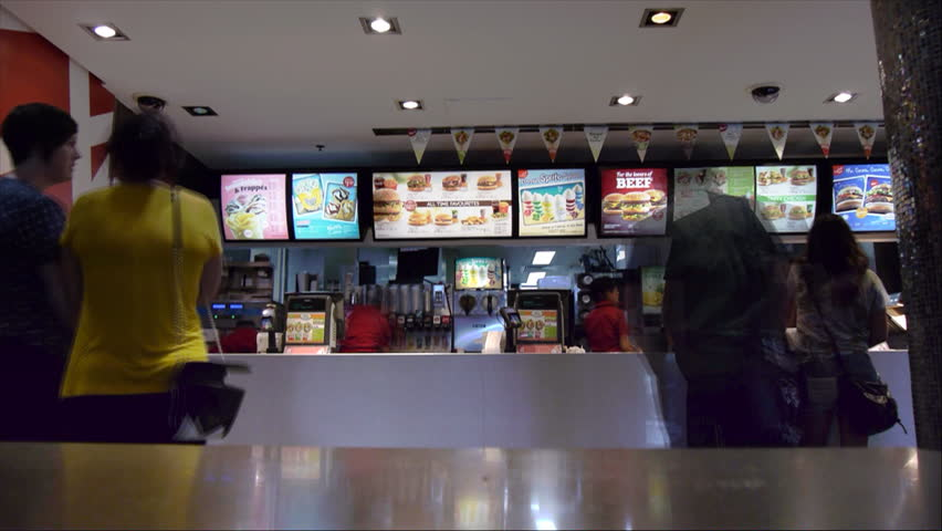 SYDNEY, AUSTRALIA - JANUARY 21, 2014: a time lapse of customers ordering food from a mcdonalds fast food restaurant