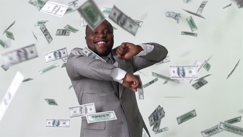 Slow-motion of an African-American businessman dancing among falling dollar bills in slow motion | Shutterstock HD Video #5559368