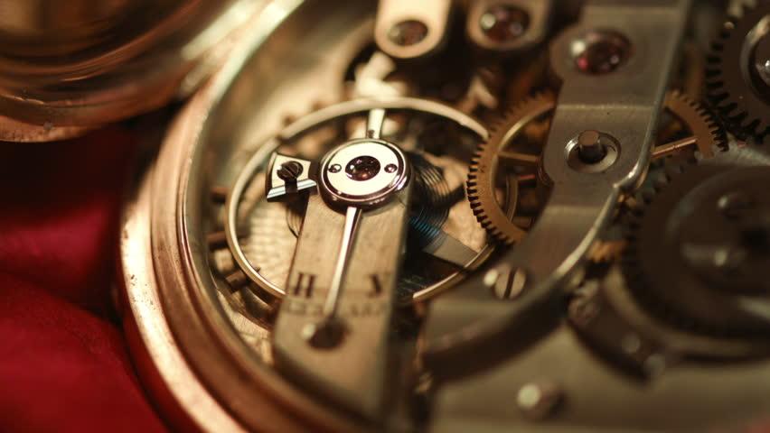 Old golden clock mechanism working, closeup shot with soft focus (hd, high definition, 1920x1080, 1080p)