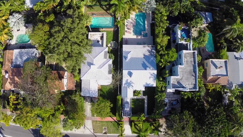 Aerial video of houses with swimming pools