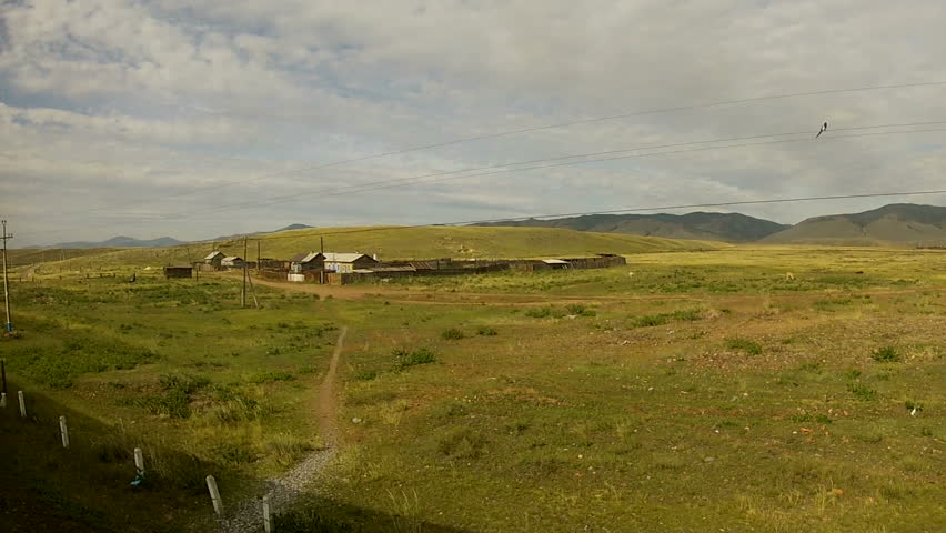 Trans-Siberian Railway train passing by a little village in siberia
