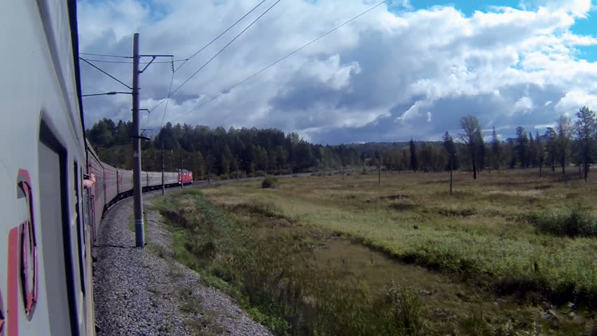 Trans-Siberian Railway train in a sharp curve between the forest