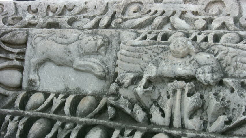 Medium close up pan across bas relief detail at angkor wat for Bas relief mural