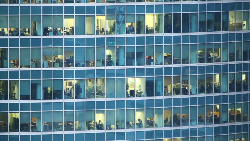 building an office. many people in a windows of modern skyscraper office building - hd stock video clip an