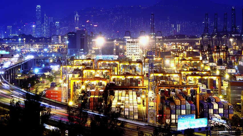 Containers Port Timelapse at Night. 4K Hong Kong. Tight Static Shot. Cargo containers loading activities in cargo terminal. Office buildings at the back. Busy traffic on the main road at rush hour.    Shutterstock HD Video #5633354