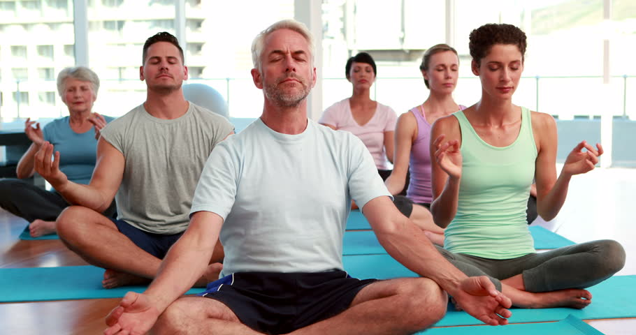 Stock Video Of Yoga Class Sitting In Lotus Position