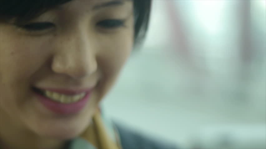 Close Up of A Woman's Face On A Train, Smiling At The View