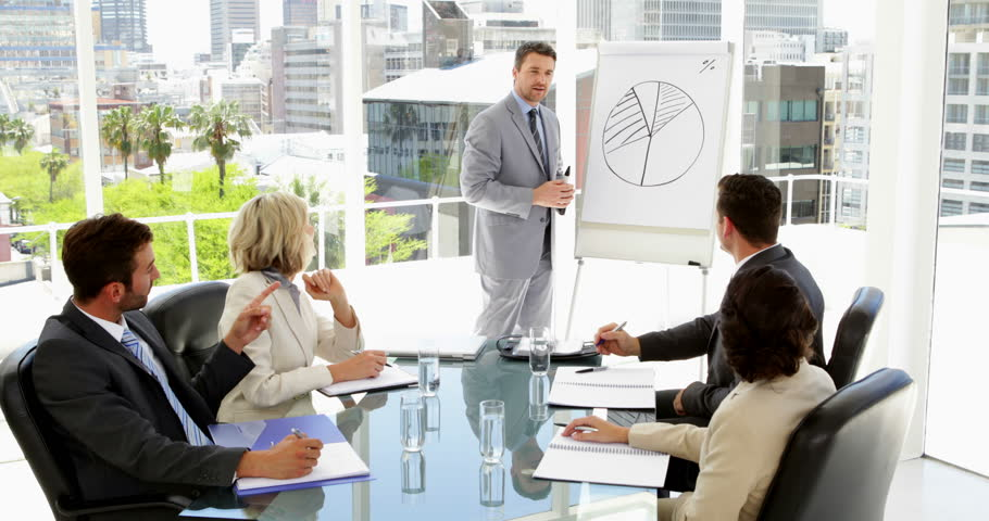 Businessman giving presentation to colleagues in the office