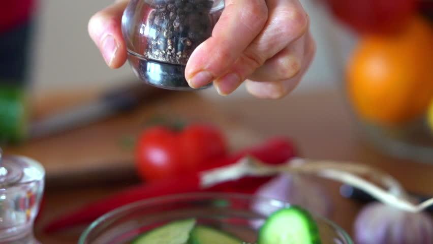 Sprinkle pepper on cucumber salad, super slow motion, shot at 240fps
