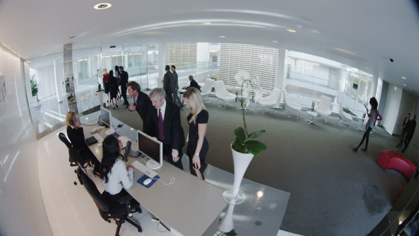 Cctv Camera View Of Business People In Lobby Of Large