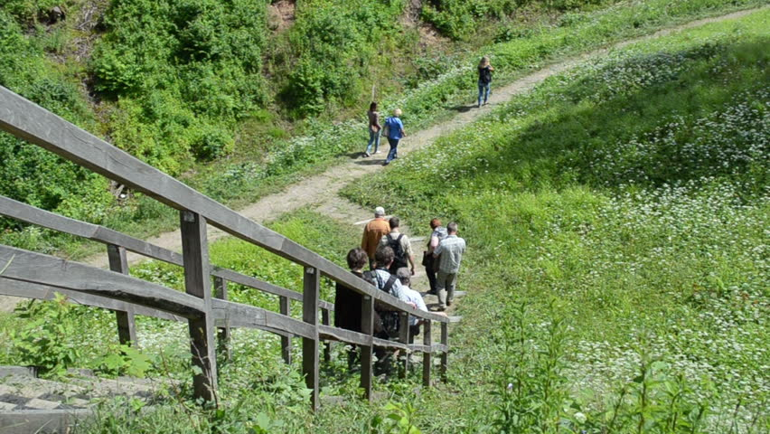 DUKSTAI, LITHUANIA   CIRCA JUNE 2013   People Tourists Descend Down From  Mound Hill On