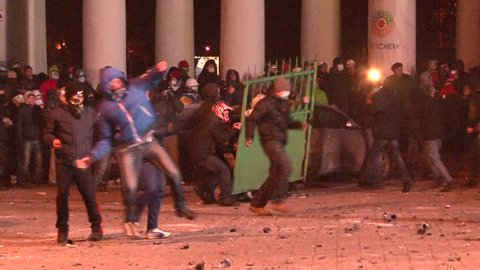 KIEV, UKRAINE - JANUARY 20, 2014: Protesters attacked police during clashes in Kiev on the street Grushevskogo, throwing stones, set cars alight