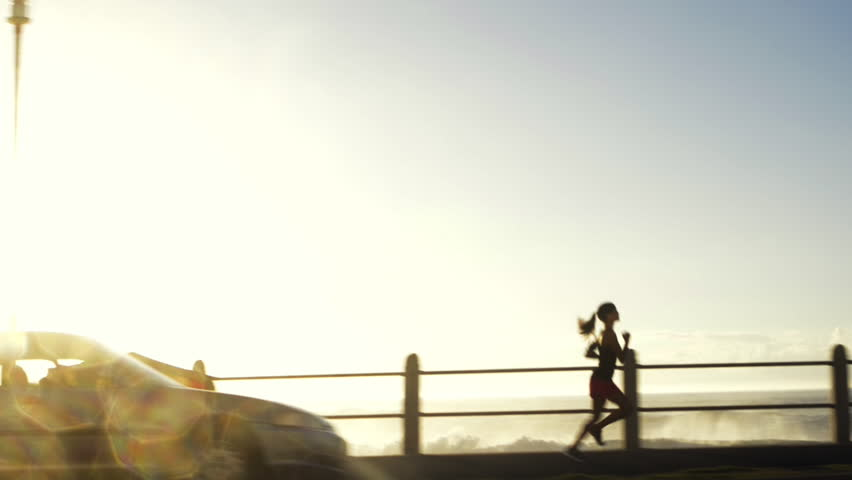 Mixed race woman runner running on road