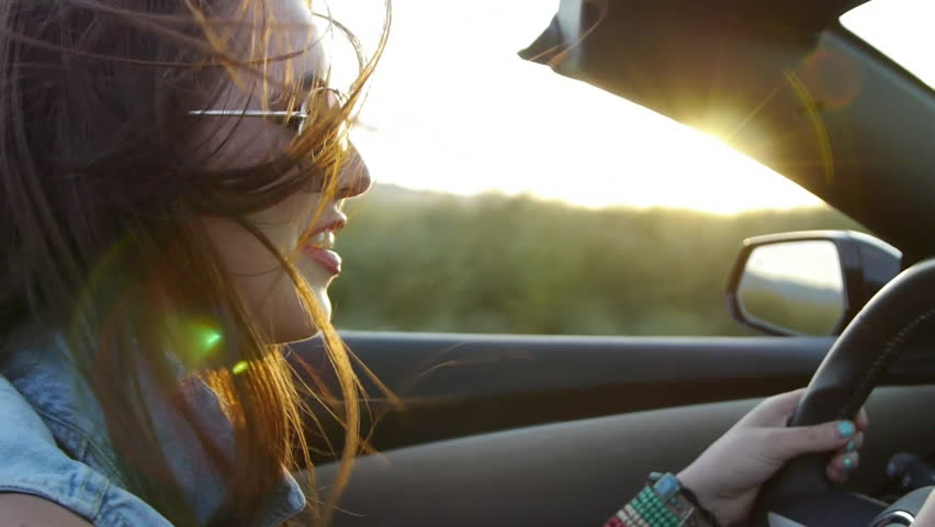Profile Of A Beautiful Teen, Driving In Desert At Sunset | Shutterstock HD Video #5765882
