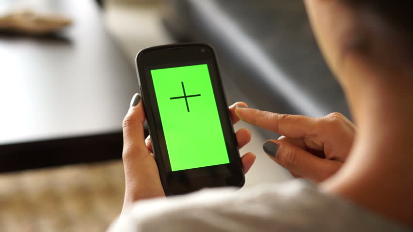 Woman using a mobile phone with green screen #5789930