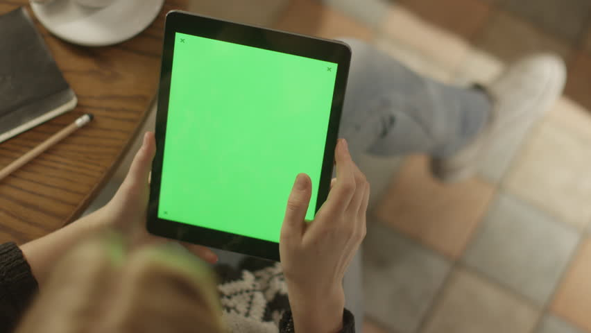 Girl Using Tablet PC with Green Screen. Shot on RED Digital Cinema Camera in 4K (ultra-high definition (UHD)), so you can easily crop, rotate and zoom. Easy for tracking and keying. ProRes HQ codec.  | Shutterstock HD Video #5793371