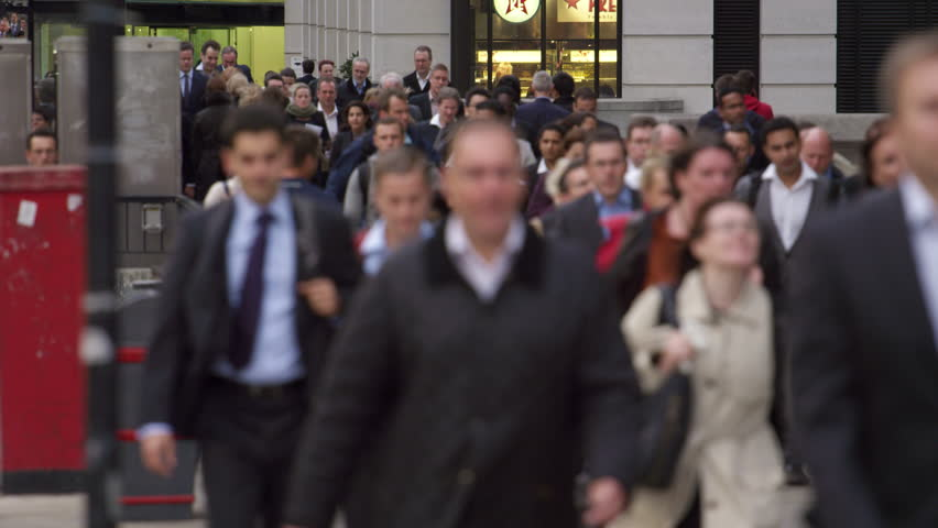 LONDON, UK - OCTOBER 10, 2011: Commuters on a busy street in London