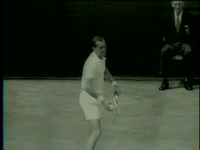 Ashley Cooper, serves against Neale Fraser, both from Australia, and doesn't defeat in the final game at Wimbledon, London circa 1958 - MGM PICTURES, UNIVERSAL-INTERNATIONAL NEWSREEL, USA, 1958