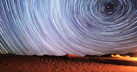 4K Stunning Star Trails Galaxy Cosmos Time-lapse over Death Valley Desert in California. Polaris North Star at center as earth rotates on axis. Beautiful in 4K. Featured in National Geographic.