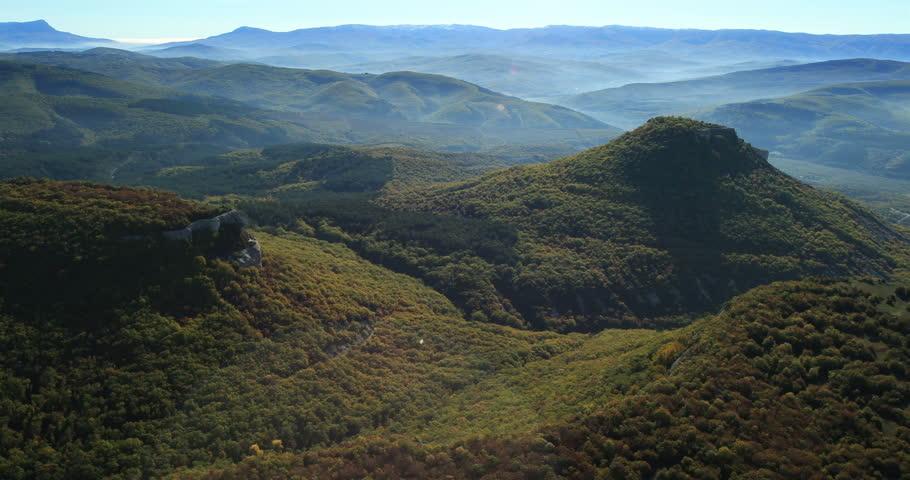 Aerial View: Chufut-Kale fortress. Mountain plateau of Burunchak, near Bakhchisaray. Kacha river canyon. Crimea. Autumn 2013. #5860850