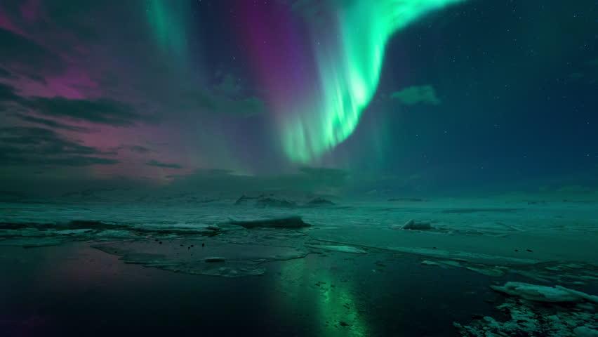 The Aurora Borealis (Northern Lights) reflecting on the Jokulsarlon Glacier Lagoon, Iceland