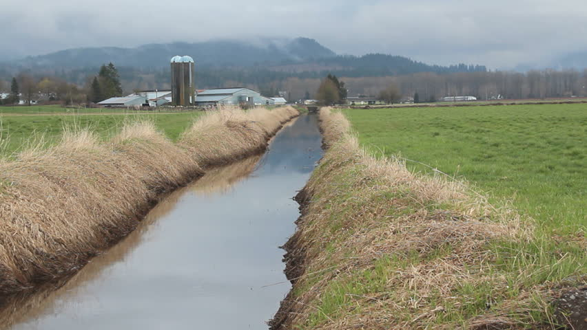 Agricultural Irrigation Canal : Farm land drainage ditch canal on agricultural for