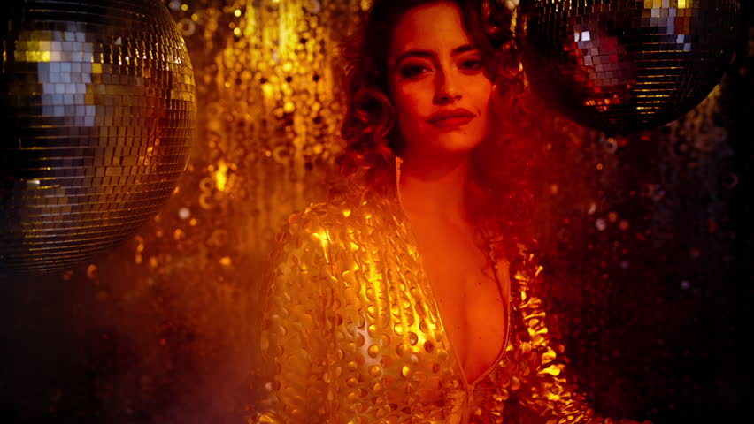 Beautiful sexy female in fantastic gold catsuit in lounge bar setting with a cocktail. Useful for parties, clubs and events  | Shutterstock HD Video #5886500