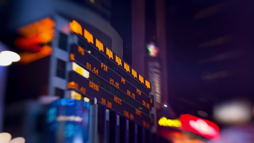 Stock market ticker screen display exchange trade data at night. Times Square, New York City. Motion background.