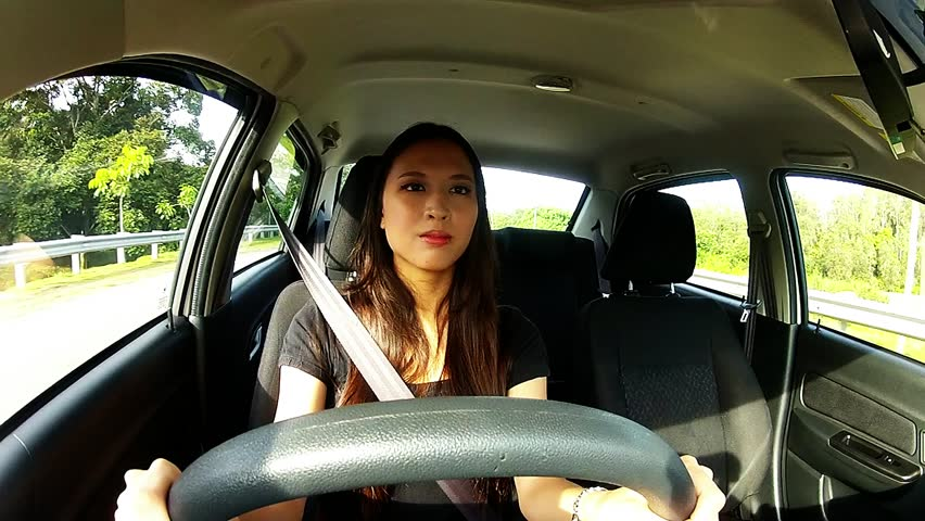Asian Woman Driving A Car Stock Footage Video 3199888  Shutterstock-9718