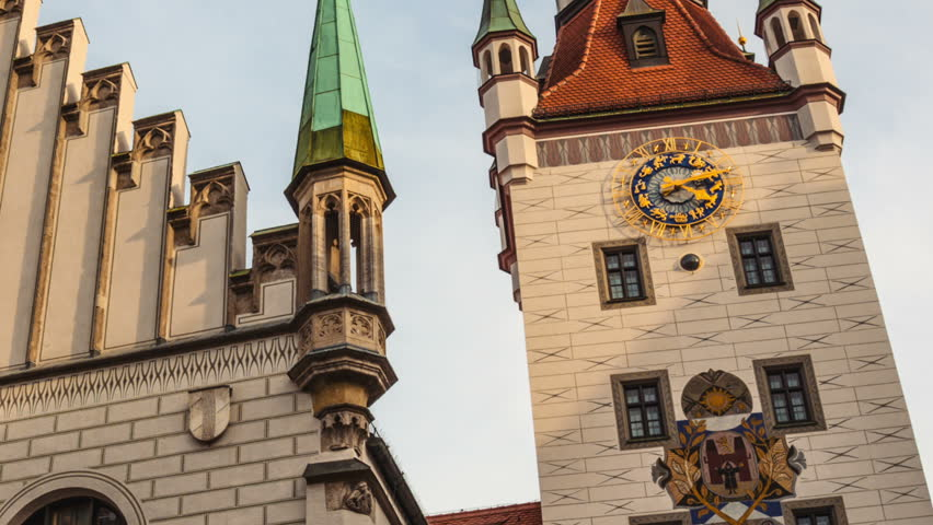 MUNICH, GERMANY - The historical town hall on the main square Marienplatz in the center of the city (hd, 1920x1080, 1080p, timelapse, time-lapse, hidef) zoom out from clock on the tower