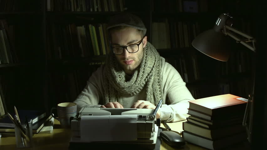 A writer typing his piece of art, crumpling and wasting a sheet of paper dissatisfied with result